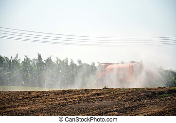 Water Truck spray to ground for protect occur dust at pond...