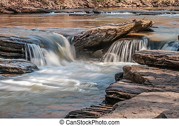 Water tumbling over rocks in a river