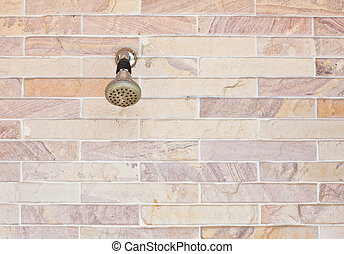 water valve on brick wall