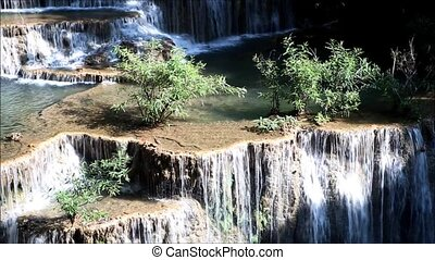 water - beautiful waterfall and green forest