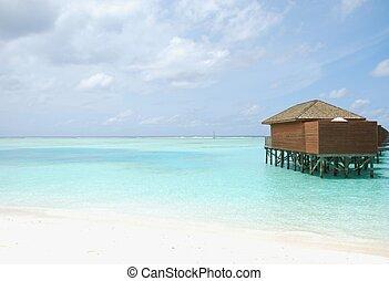 Water villas in Maldives (beach scene)