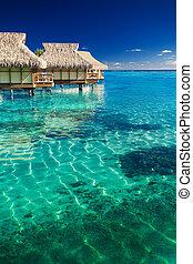 Water villas over tropical reef