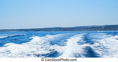 Water wake behind speed boat