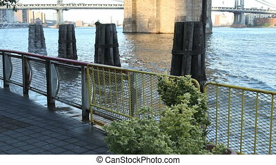 Water Wave at Brooklyn Bridge - A wave splashes at the...