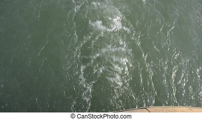 Water wave at the back of a boat. At the end of the film the...