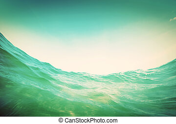 Water wave in the ocean. Underwater and blue sky. Vintage -...