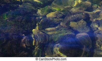 Water waves between stones.