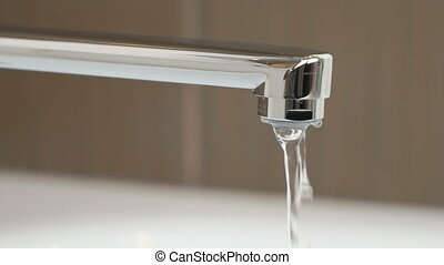 Water weak pressure flows from a water tap - Water stream...