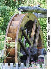 Old wooden water wheel in a garden