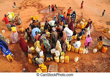 water while waiting Africans - people waiting to fill water...