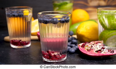 Water with infused blueberries, pomegranate and lemon. Fresh...