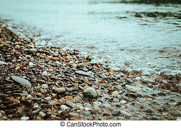 Water worn pebbles at the edge of a lake