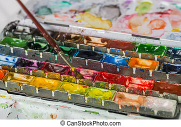 watercolor paint box with brush