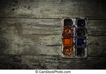 Watercolor paint on old wooden background