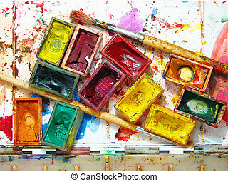Watercolor painting and artistic tools on table