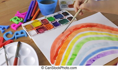 Watercolor painting. Young girl painting a rainbow -...