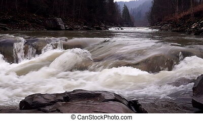 Watercourse of a Mountain Stream with Rapids