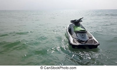 Watercraft or jet ski on the water in the sea and sunset...
