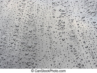 Waterdrops after rain on black cars hood