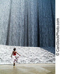 Waterfall 3 - A woman enjoying with the splendor of a...