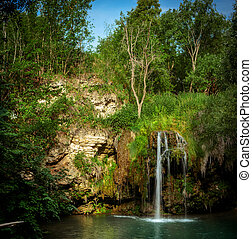 Waterfall and a beautiful lagoon lake for relaxing in the...