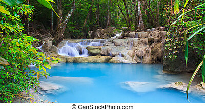 Waterfall and blue stream in the forest Kanjanaburi Thailand