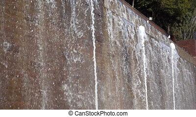 Waterfall and Brick Wall