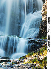 Waterfall and rocks - Waterfall in Autumn with rocks in...