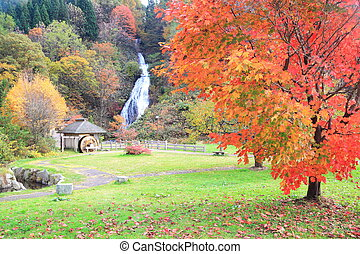 Waterfall and waterwheel in autumn - Waterfall in autumn,...