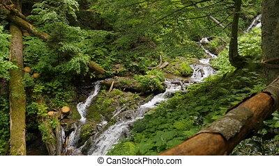 Waterfall at medelikha park slomotion long shot - Waterfall...