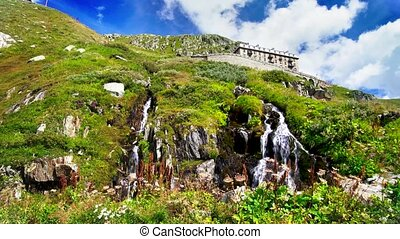 Waterfall at the Rhone Glacier at Furka Pass in the canton of Valais, Switzerland