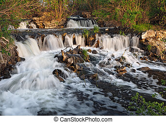 Waterfall at the sunset in forest big