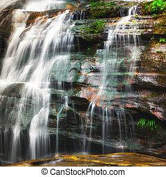 Waterfall at tropical rain forest. Thailand