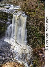 Waterfall called Sgwd Clun-Gwyn. On the river Afon Mellte South Wales, UK winter.