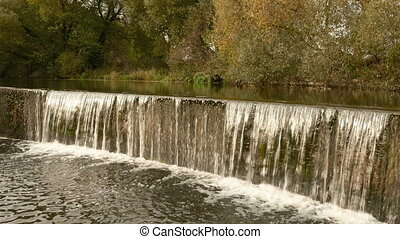 Waterfall cascade. Autumn daytime. Smooth dolly shot
