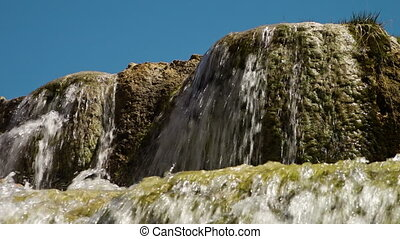 Waterfall cascading over multiple levels of rocks. - Band-e...