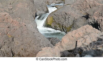 Waterfall - Closeup of a waterfall in a rocky environment on...