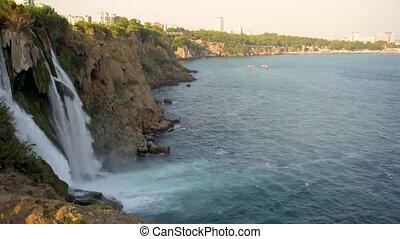 Waterfall falling into the sea
