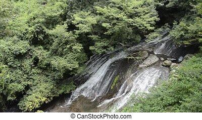 Waterfall falling over rock mass - Thin white waterfall...