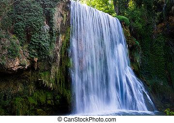 Waterfall from stone monastery. - Waterfall from stone...