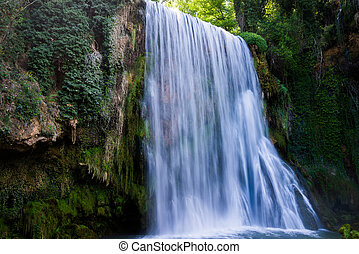 Waterfall from stone monastery. - Waterfall from stone ...