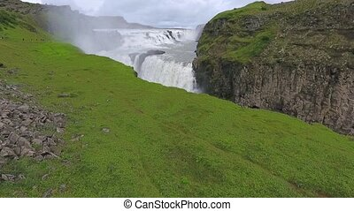 Waterfall Gullfoss among mountains. Andreev.