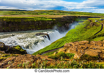 Waterfall Gullfoss - Huge masses of water crash into a...