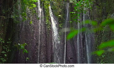 waterfall hidden in jungles. Area around Gunung Kawi temple...