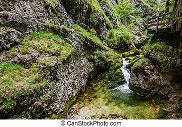 waterfall in a clammy in the mountains