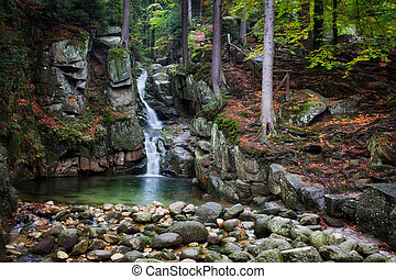 Waterfall in Autumn Forest of Karkonosze Mountains