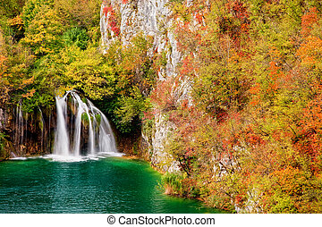 Waterfall in Autumn Forest - Waterfall in autumn scenery of...