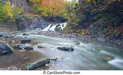 Waterfall in autumn season