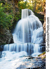 Waterfall in Autumn with rocks in mountain and woods. From ...