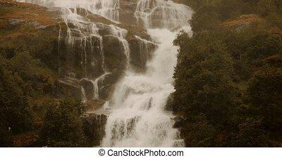 Waterfall In Briksdalsbreen Valley In Heavy Rain, Norway -...